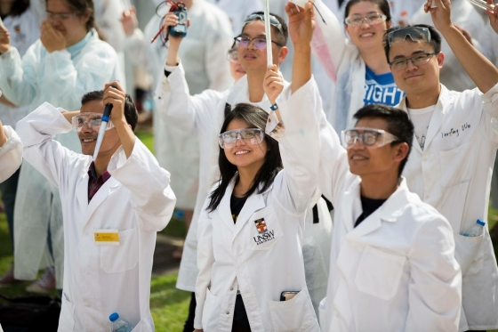 Science students at UNSW in labcoats in a crowd