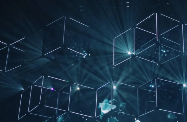 A light production showcasing geometric neon shapes