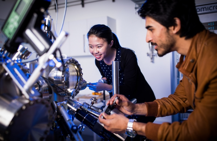 Student looking at a quantum machine