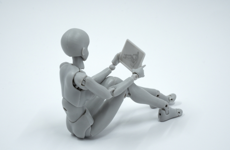 Model of a person sitting with a tablet