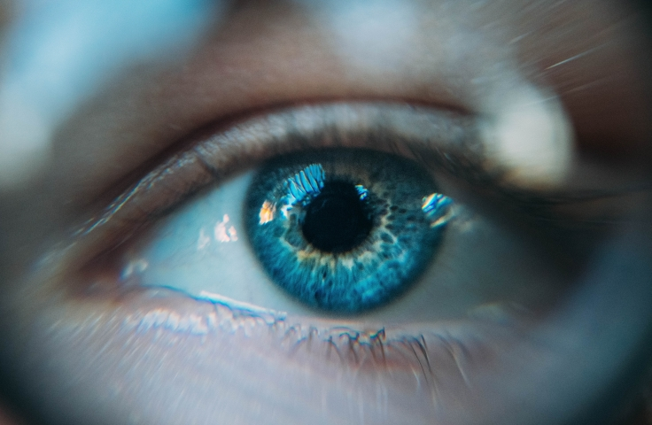 A close up image of a person's blue eye