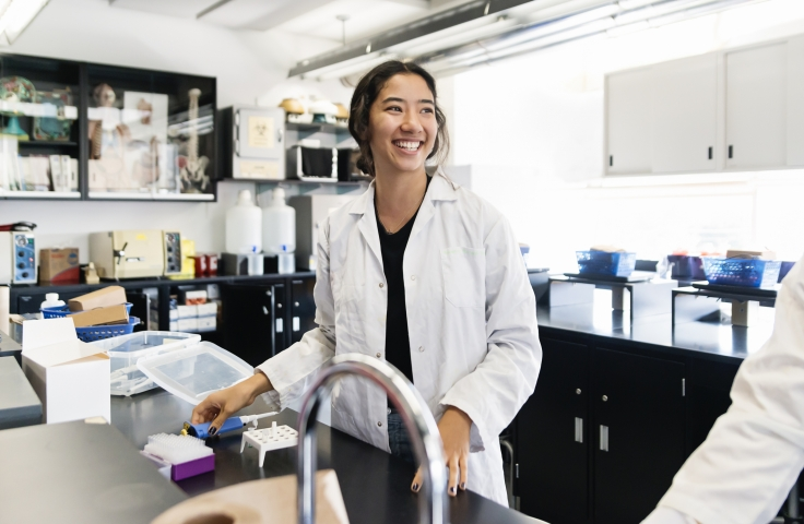 Student smiling in a lab