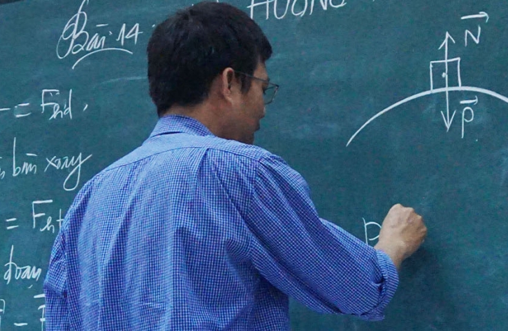 person writing on the chalkboard mathematics